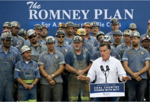 Mitt Romney lying in front of hard working miners